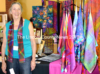 Fabric artist Phyllis Harper Loney of Round Pond displays her art quilts, wall-hangings and silk scarves at the Washington Schoolhouse annual Arts at the Schoolhouse, July 26. (Tim Badgley photo)