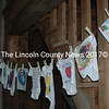 Baby shower guests decorate onesies for the twins expected by Leung. (Eleanor Cade Busby photo)