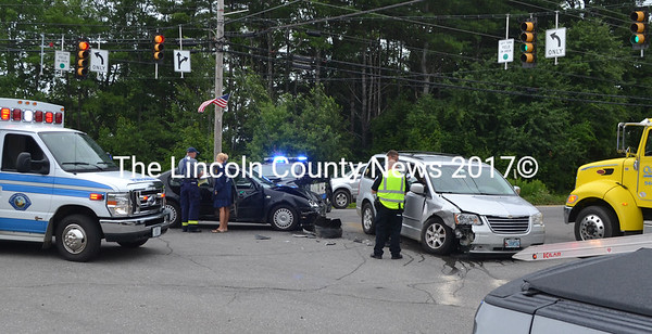 This minivan and sedan collided on Main Street in Damariscotta when the van operator attempted to make a left turn onto Biscay Road, according to police. (D. Lobkowicz photo)