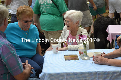 Wiscasset resident Ruth Applin (center) visits with friends at the On Common Cafe during Summerfest in Wiscasset. (Charlotte Boynton photo)