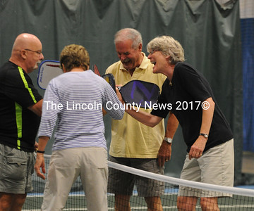 Each pickleball match ends with a friendly  paddle handle tap over the net. Pictured are Dick Dunphey, Susan Beaudette, Bruce Beaudette and Anne Jackson. (Paula Roberts photo)
