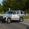 Route 1 traffic in Waldoboro is routed around an accident involving a Jeep SUV and a Mack truck Aug. 4. The Mack truck is seen in the distance on the right side of the highway. (Greg Latimer photo)