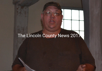 Alna Fire Chief Mike Trask speaks at a special town meeting at the Alna Meetinghouse Monday, Aug. 25. Trask advocated for the town to contract with Hanley Construction Inc. to plow town roads instead of Hagar Enterprises Inc., the only bidder for the work. (Charlotte Boynton photo)