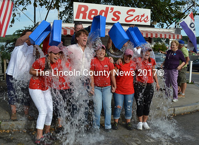 The day shift at Red's Eats took the ALS Ice Bucket Challenge after completing their shift, Aug. 20. They challenged Wiscasset Town Garage Crew, The Old Goat in Richmond, and the Ideal Portable Toilets of Wiscasset to take their turn for ALS. (Charlotte Boynton photo)