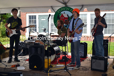 Double Jinx opens the Music Under the Tent event as part of Whitefield Community Day. From left is Connor McLean, Joshua Chaine, Milo Caputo, and Josh Ciichowski. (Kathy Onorato photo)