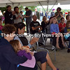 The  Whitefield community gathers under the tent to enjoy the music of local artists Saturday, Sept. 13. (Kathy Onorato photo)