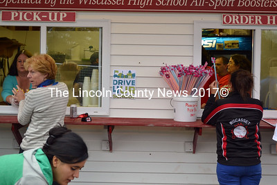 Wiscasset All-Sports Boosters work hard to keep hungry soccer fans fed during a double-header on Sept. 13. (Kathy Onorato photo)