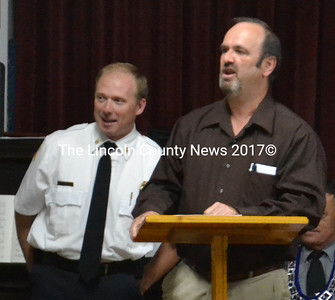 Waldoboro Fire Chief Paul Smeltzer (left) was presented the 2014 Spirit of America award by Rick Grotton on behalf of Meenhaga Grange. (D. Lobkowicz photo)