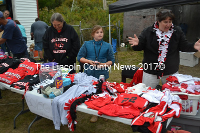 Selling Wolverine spirit wear are Wiscasset All-Sports Boosters from left,  Louise Speece, and Caroline and Karen Potter. (Kathy Onorato photo)
