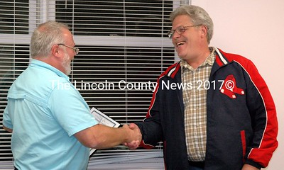 Newcastle Board of Selectmen Chairman Brian Foote (left) presents the Spirit of America Award to Richard McFarland at the Newcastle town office Monday, Sept. 23.