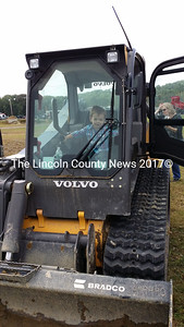 Two-year old Davey Osier of Bremen takes the controls of bulldozer during the Touch the Truck event Sept. 21. (Kathy Onorato photo)