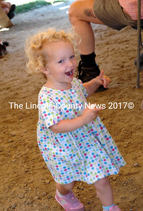 Lila Childs, 2, from Williston Vermont had a hard time choosing between dancing to Old Grey Goose or eating, so she did both. (Eleanor Cade Busby photo)