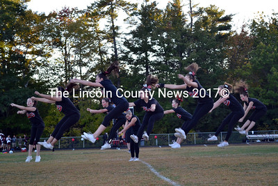 The Wiscasset Heat competitive cheering squad performs with precision during a pre-game performance. (Kathy Onorato photo)