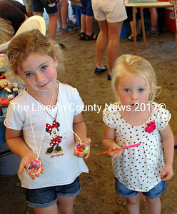 Lee Ann Lord, 5, and sister Norah, from Round Pond, made Oyster Necklaces at the Pemaquid Ouyster Festival's craft table. (Eleanor Cade Busby photo)