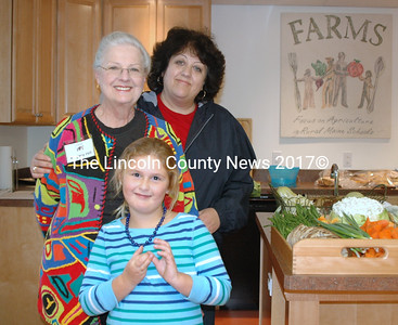 FARMS Board Member Virginia Hil, her daughter Deborah MacDonald and granddaughter Hadley Angell took in the open house at the new FARMS Community Kitchen and Learning Center. (Ellie Busby photo)