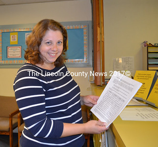 Wiscasset resident Andrea Main checks the signatures on a citizens's petition regarding the closing the Wiscasset Primary School. (Charlotte Boynton photo)