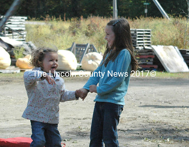 The Lopresti girls danced for joy when their father's pumpkin weighed in at 1,400 pounds. (Eleanor Cade Busby photo)