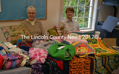 Becky Lenz (left) and Martha Speed work the First  Congregational Church's Organ Society craft table during Oktoberfest Oct. 4. (Kathy Onorato photo)