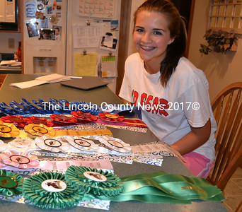 Lindsey Gordon shows off the 28 ribbons she has earned in various horse show competitions. (Kathy Onorato photo)