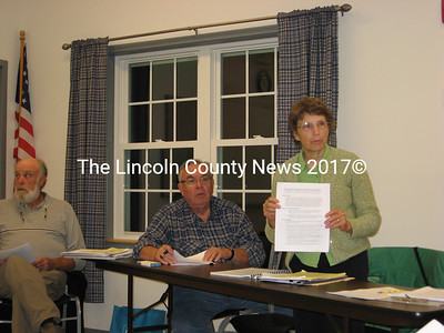 Planning board member Marianne Marple refers to one section of the new proposed mining rules. At left are board chairman Jim Torbert and board member Carl Ribeiro.  (Lucy Martin photo)