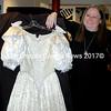 "Daphne Stern admires the ""Cinderella"" ballgown created by Sue Ghoreyeb. (Eleanor Cade Busby photo)"