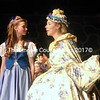 """Belle ( Somerset Ganz) listens to Mrs Potts (Julia Clark) as she explians that the Beast is not all bad in the MVHS Players' production of """"Beauty and the Beast."""" (E. Busby photo)"""