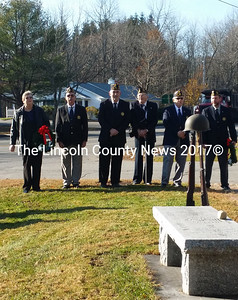 Legionaries gather to honor other veterans in Wiscasset Nov. 11. Left to right, American Legion Auxiliary President Diane Munsey, Legionnaires, John Kennedy, James Savage. Donald Munsey, Wally Pitcher, and Neil Page. (Charlotte Boynton photo)