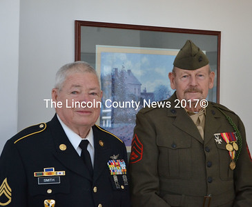 Veterans Donald Smith (left) and Gary Pitcher stand in uniform in the Schooner Cove dining hall after a Veterans Day speech, Nov. 11. Smith served in the U.S. Army and Marine Corps, and Pitcher served in the Marine Corps. (Michelle Switzer photo)