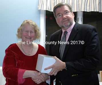 Employee Recognition Award recipient Jaqueline Hart receives congratulations and a gift from Mobius Inc. President William Floyd at the agency's annual meeting in Damariscotta Monday, Nov. 10. (J.W. Oliver photo)