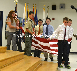 Medomak Middle School students and teacher Lorraine Knight carry in an American flag for a flag fold ceremony. (D. Lobkowicz photo)