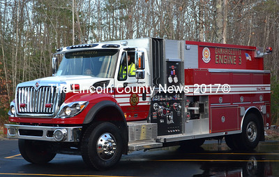 Fire chief John Roberts and son Matthew sit inside Damariscotta's new fire truck, Nov. 14. The new truck will be on display during an open house and wet down ceremony Saturday, Dec. 6. (Michelle Switzer photo)