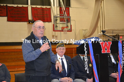 Former Wiscasset High School teacher and assistant principal Gene Stover addresses Wiscasset High School students after being presented with the American flag that was replaced in the flag assembly Friday, Nov. 14. (Abigail Adams photo)