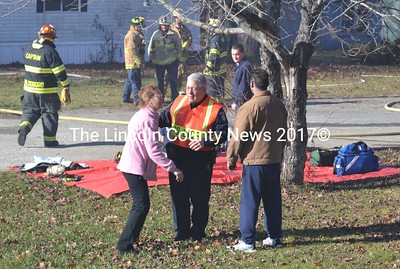 Waldoboro Police Chief Bill Labombarde steps in to separate roomates Elizabeth Cunningham and Eric Buckley as firefighters extinguish a blaze started by Buckley in their home on Union Road in November 2013. (LCN file/D. Lobkowicz photo)
