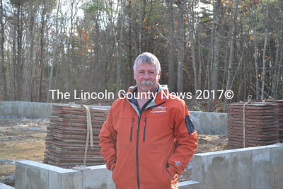 """Frank """"Bud"""" Gallagher stands in front of the future home of Floatworks Inc. at 654 Bath Rd. in Wiscasset Thursday, Nov. 13. The Wiscasset Planning Board recently approved Gallagher's site plan review application and he will open for business soon."""