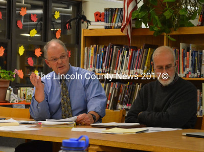 """AOS 93 Superintendent Steve Bailey explains the changes in the revised policy to the Great Salt Bay school board in a meeting, Nov. 12. . GSB Board chair and Bremen representative William """"Bill"""" Thomas is on the right. (Michelle Switzer photo)"""