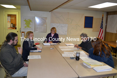 Clockwise from left: Michael Kastelein, Tamyln Frederick, Sherry Tibbets, Jack Sarmanian, and Jessica Chubbuck sit around the table at the Edgecomb Board of Selectmen's meeting Monday, Nov. 17. Michael and Kate Kastelein have filed a civil suit against the town of Edgecomb and the Edgecomb Planning Board in hopes of reversing the planning board's decision to give The Coastal Dog Inc. an agricultural use designation.