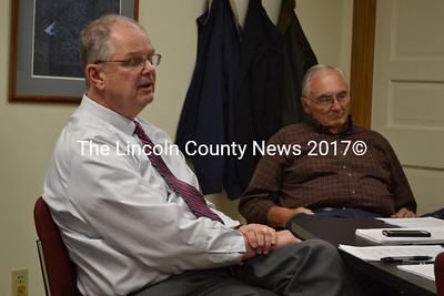 Superintendent Steve Bailey (left) explains the AOS 93 central office budget proposal to the AOS 93 Executive School Board in a meeting, Nov. 13. The board voted to approve the budget proposal, and to add a 20 hour accounts receivable/payable position. (Michelle Switzer photo)