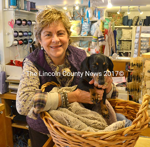 "Karen Okie and her dog, Schatzi, at Sheepscot River Pottery in Edgecomb. Customers who make donations to Lincoln County Animal Shelter during ""Schatzi's Birthday Weekend"" (Dec. 6 and 7) at Sheepscot River Pottery in Edgecomb or Damariscotta can select a paper bone, good for between a 10 and 20 percent discount from the store. (D. Lobkowicz photo)"