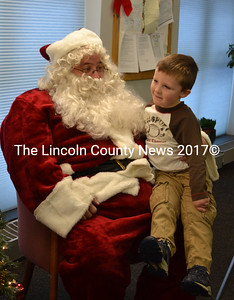 "Santa Claus listens as Chase relates what he would like for Christmas during ""Breakfast with Santa,"" at the Wiscasset Community Center Dec. 13. (Charlotte Boynton photo)"