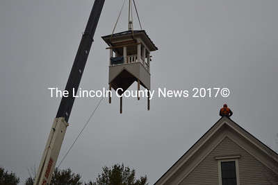After seven years, and $40,000 raised by donations and fundraisers put on by the Round Pond Schoolhouse Association, the Washington School's belfry was raised and attached to the 1885 building, Dec. 16. (Michelle Switzer photo)