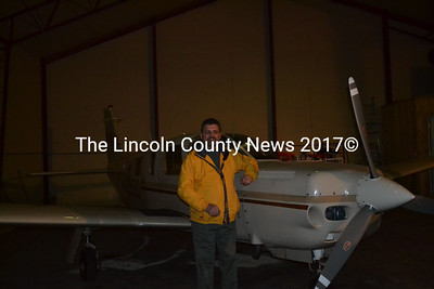 Ervin Deck stands with his airplane in a hangar at the Wiscasset Airport. (Abigail Adams photo)