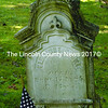 Elaborate workmanship went into the design of this headstone for Elbridge Dexter Hall. His Civil War service is honored with the American flag.  (Laurie McBurnie photo)