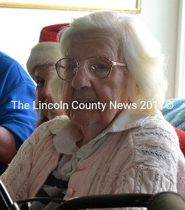 Waldoboro Green resident Jolan Frazzetta (foreground) and staff member Diana Lewis listen to Miller School kindergarten and pre-K students sing carols Dec. 15. (D. Lobkowicz photo)