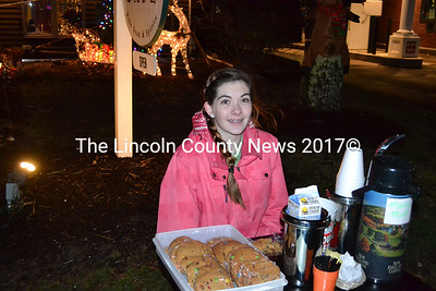 Jazmine Audet, of the Salt Bay Cafe, sits with free mocha mint coffee and chocolate chip m&m cookies during the eighth annual Wrap it Up Festival, Dec. 18.  (Michelle Switzer photo)