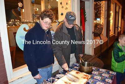 Jalen Holmes (left) and Rick Hirsch of the Damariscotta River Grill make Maine maple syrup taffy during the eighth annual Wrap it Up Party, Dec. 18. (Michelle Switzer photo)
