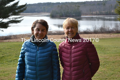 Sisters and Chewonki Campground owners Pam Brackett (left) and Ann Beck stand in front of some prime campsites at the campground in Wiscasset Dec. 22. (Abigail Adams photo)