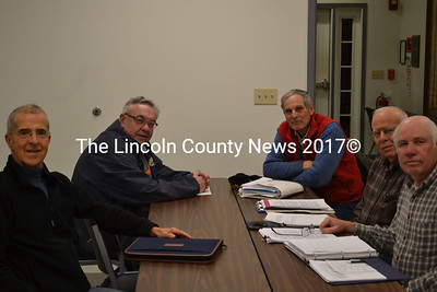 Clockwise from left: Whitefield roads committee members John Parks, Carl Ribeiro, Louis Sell, David Hayden, and Selectman Dennis Merrill MEET at the Whitefield Fire Station Dec. 18. (Abigail Adams photo)