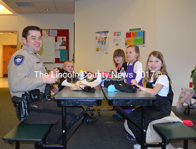 "Lincoln County Sheriff's Deputy Jared Mitkus sits with Edgecomb Eddy School kindergardeners for the Dine with a Deputy meal, Dec. 19. ""It's fun, I get to be a kid again, at least for an hour,"" Mitkus said. (Michelle Switzer photo)"