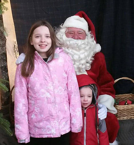 Kaylin and Benjamin Lizotte meet with Santa after riding the train at Wiscasset, Waterville & Farmington's Victorian Christmas event in Alna on Dec. 20. (Photo courtesy Kathy Lizotte)