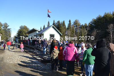 Parents and children line up at the Sheepscot Railway Station to enjoy a trip on the Wiscasset Waterville & Farmington Victorian Christmas ride to Alna Center. (Charlotte Boynton photo)